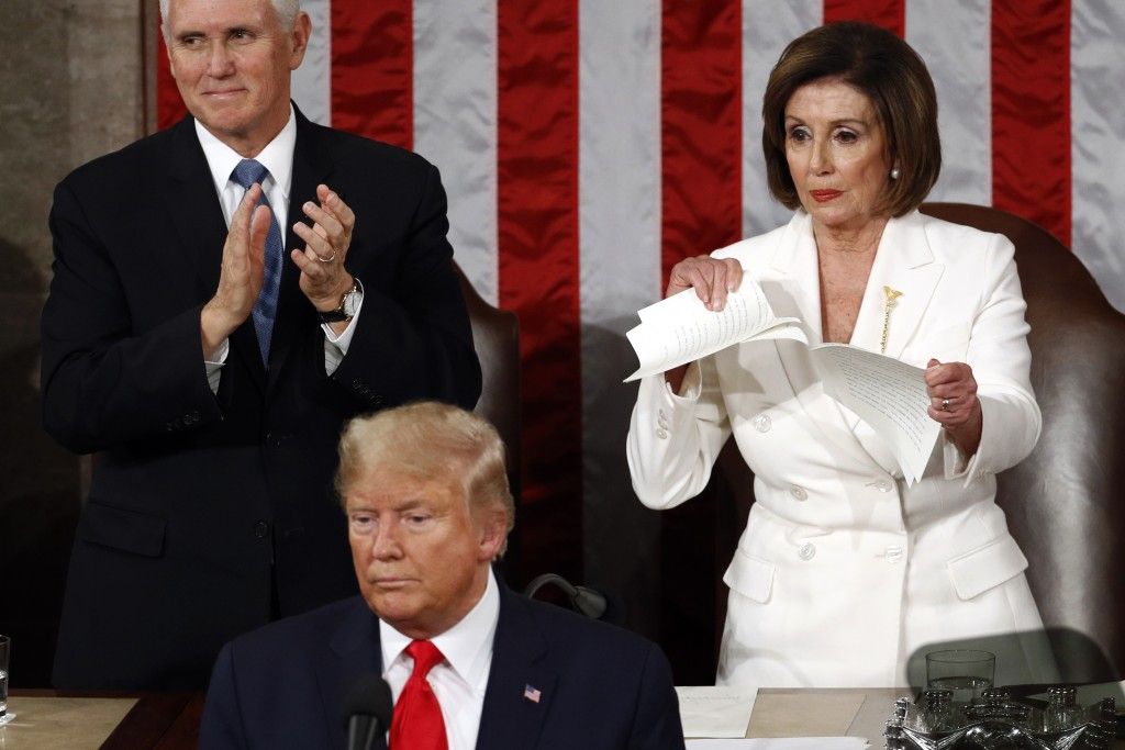 House Speaker Nancy Pelosi of Calif., tears her copy of President Donald Trump's s State of the Union address after he delivered it to a joint session...