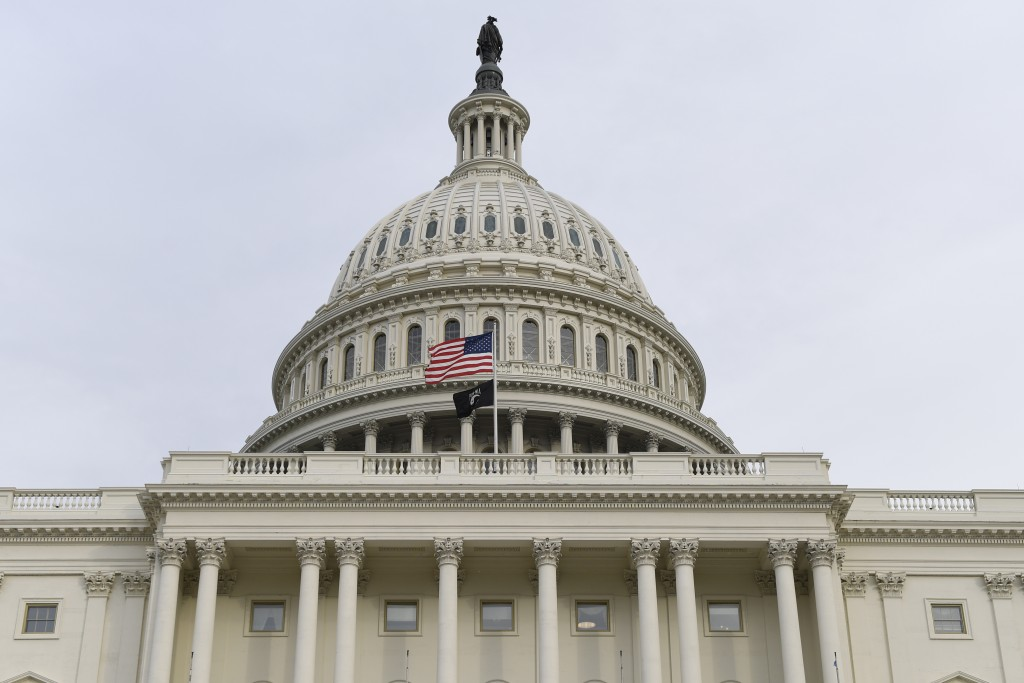 The flag flies outside the U.S. Capitol ahead of President Donald Trump delivering his State of the Union address to a joint session of Congress on Ca...