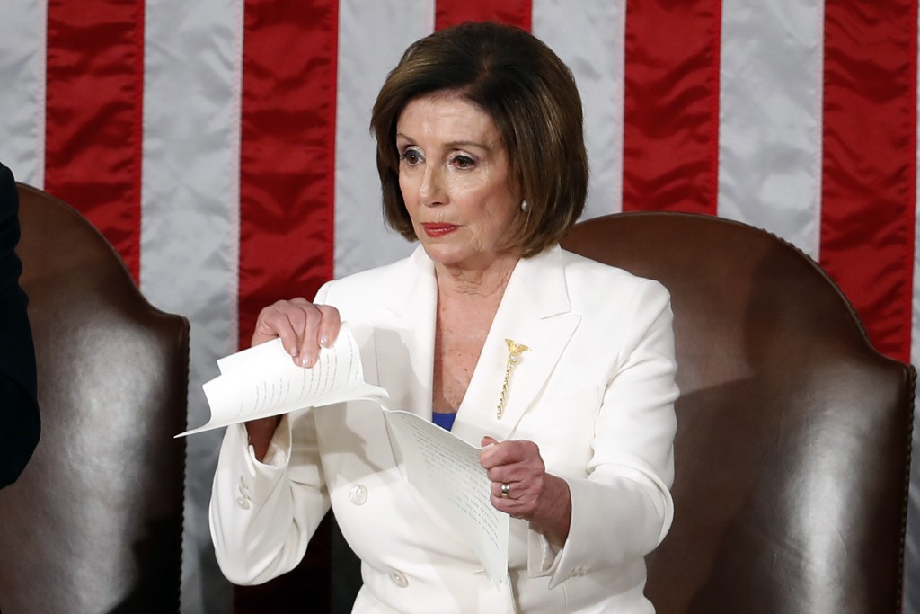 House Speaker Nancy Pelosi of Calif., tears her copy of President Donald Trump's State of the Union address after he delivered it to a joint session o...