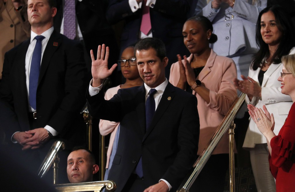 Venezuelan opposition leader Juan Guaido waves as President Donald Trump delivers his State of the Union address to a joint session of Congress on Cap...