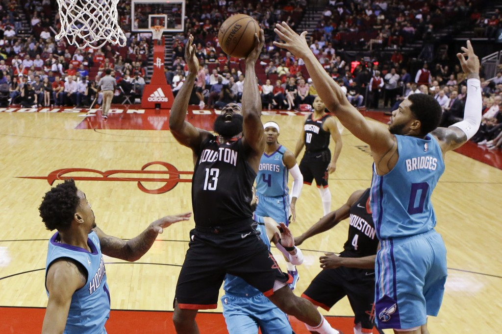 Houston Rockets guard James Harden (13) shoots as Charlotte Hornets forward Miles Bridges (0) defends during the first half of an NBA basketball game ...