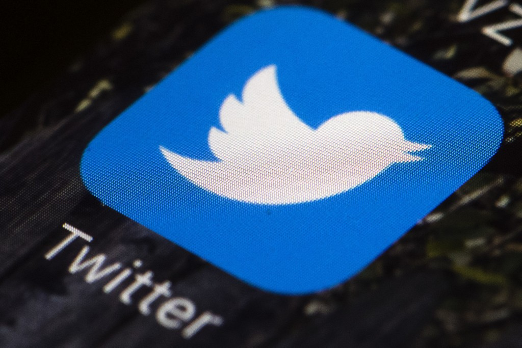 FILE - This April 26, 2017, file photo shows the Twitter app icon on a mobile phone in Philadelphia. Twitter will begin to label and in some cases rem...