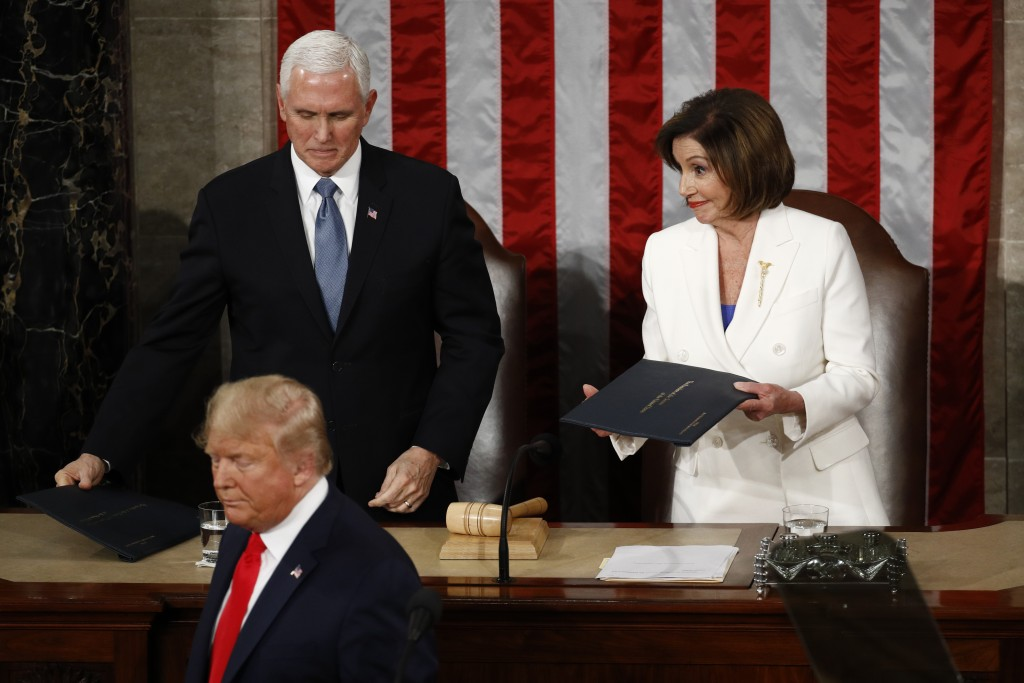 President Donald Trump turns after handing copies of his speech to House Speaker Nancy Pelosi of Calif., and Vice President Mike Pence as he delivers ...