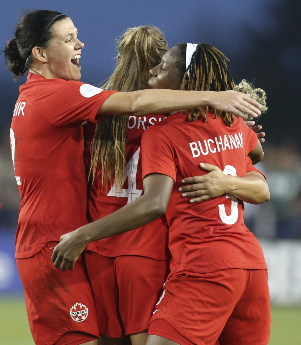 Canada's Christine Sinclair (19) and teammates Shelina Zadorsky(4) and Kadeisha Buchanan (5) celebrate a goal during a CONCACAF women's Olympic qualif...
