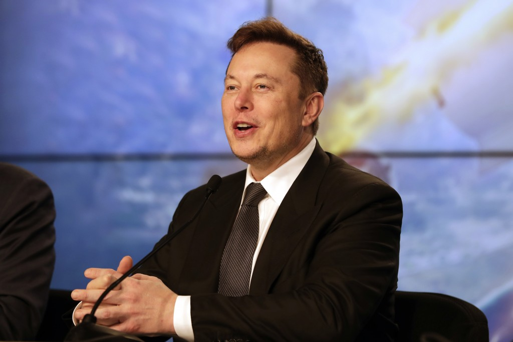 FILE - In this Jan. 19, 2020, file photo Elon Musk, Tesla CEO, speaks during a news conference at the Kennedy Space Center in Cape Canaveral, Fla. Tes...