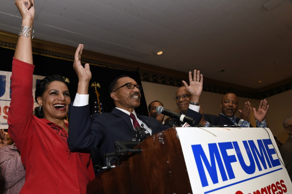 Kweisi Mfume, second from left, Democratic nominee for Maryland's 7th Congressional District, speaks at a victory party with his wife, Tiffany, left, ...