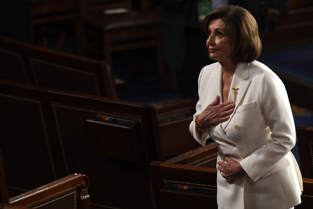 House Speaker Nancy Pelosi of Calif., bows to the guests seated in her gallery seats after President Donald Trump delivered his State of the Union add...
