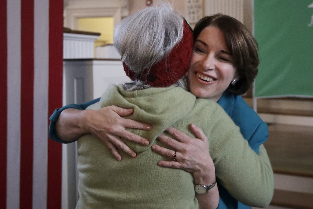 Democratic presidential candidate Sen. Amy Klobuchar, D-Minn., hugs a woman after speaking at a campaign event, Tuesday, Feb. 4, 2020, in Portsmouth, ...