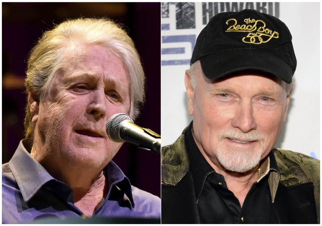 """This combination photo shows Brian Wilson performing at the Rosemont Theatre in Rosemont, Ill, on Oct 6, 2017, left, and  Mike Love at """"Howard Stern's..."""