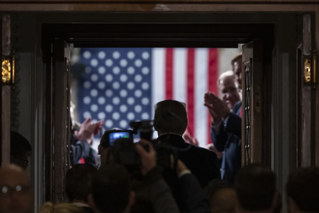 President Donald Trump enters the House floor where he will give his State of the Union address to a joint session of Congress in the House Chamber on...