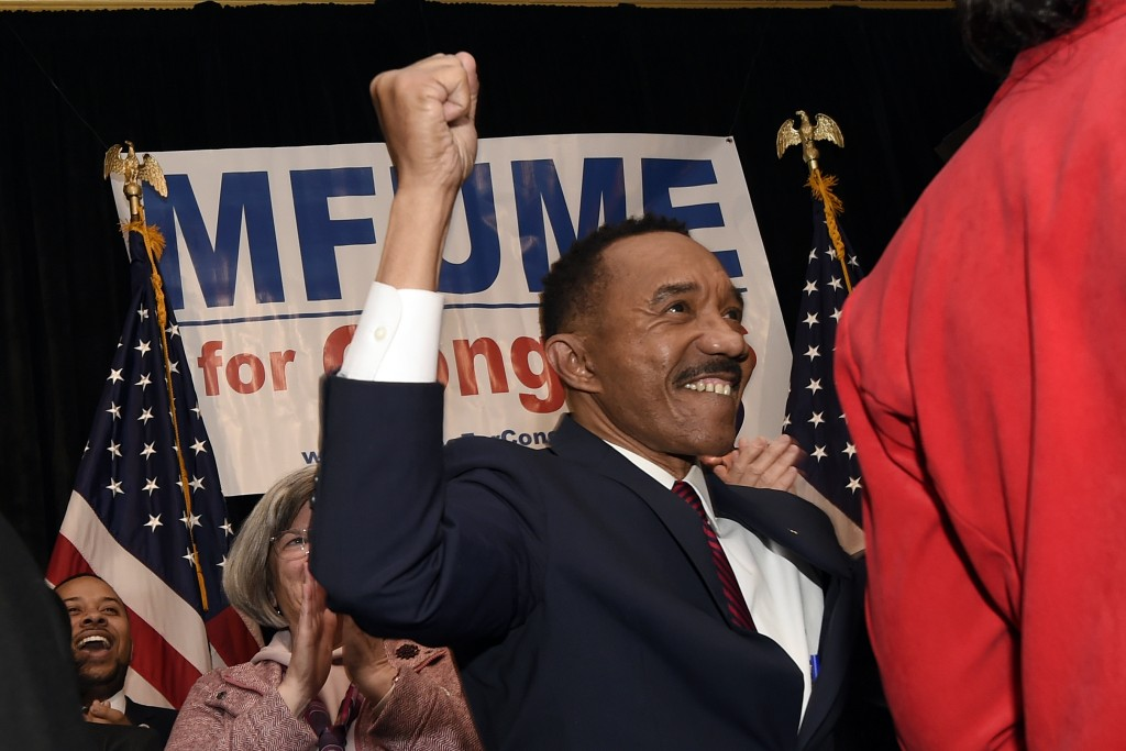 Kweisi Mfume, Democratic nominee for Maryland's 7th Congressional District, raises his fist at a victory party, Tuesday, Feb. 4, 2020, in Baltimore. (...
