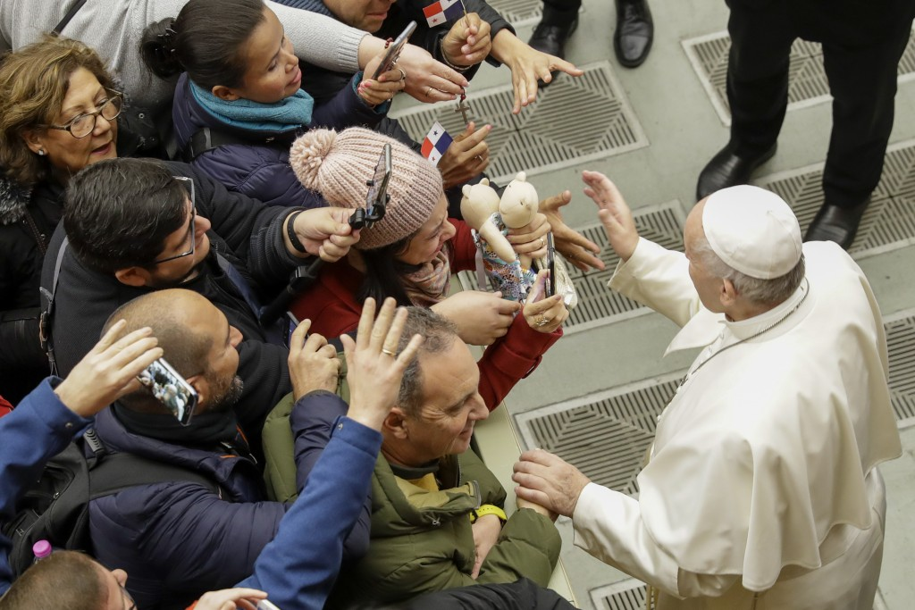 Pope Francis greets people during his weekly general audience in the Pope Paul VI hall at the Vatican, Wednesday, Feb. 5, 2020. (AP Photo/Andrew Medic...