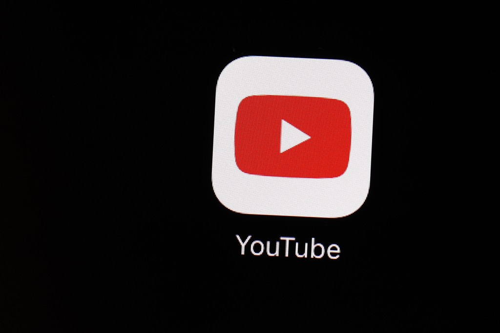 FILE - This March 20, 2018 file photo shows the YouTube app on an iPad in Baltimore. YouTube is demanding that a facial recognition company that works...