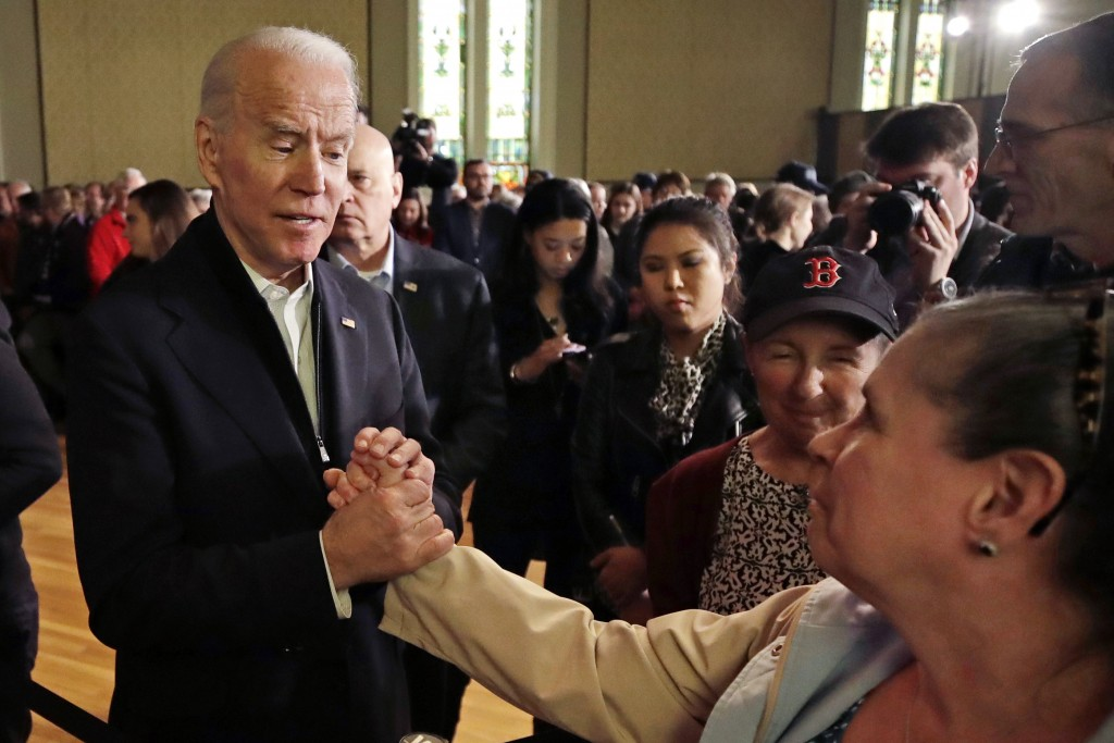 Democratic presidential candidate former Vice President Joe Biden holds a woman's hand while speaking to her at a campaign event, Wednesday, Feb. 5, 2...