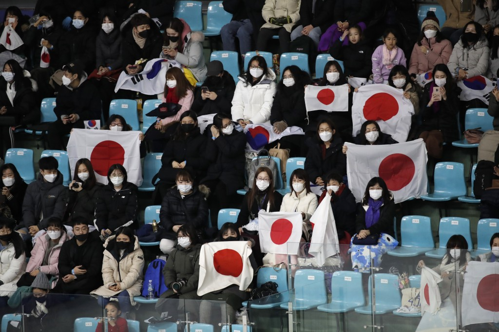 Fans hold Japanese flags during the ladies' single short program competition in the ISU Four Continents Figure Skating Championships in Seoul, South K...