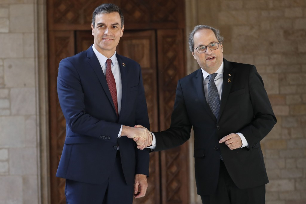 Spanish Prime Minister Pedro Sanchez, left, shakes hands with Catalan regional President Quim Torra at the Palace of the Generalitat, the headquarter ...