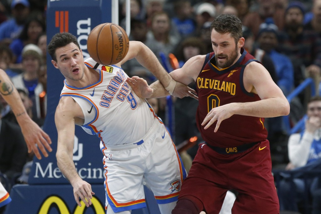 Oklahoma City Thunder forward Danilo Gallinari (8) knocks the ball away from Cleveland Cavaliers forward Kevin Love (0) during the first half of an NB...