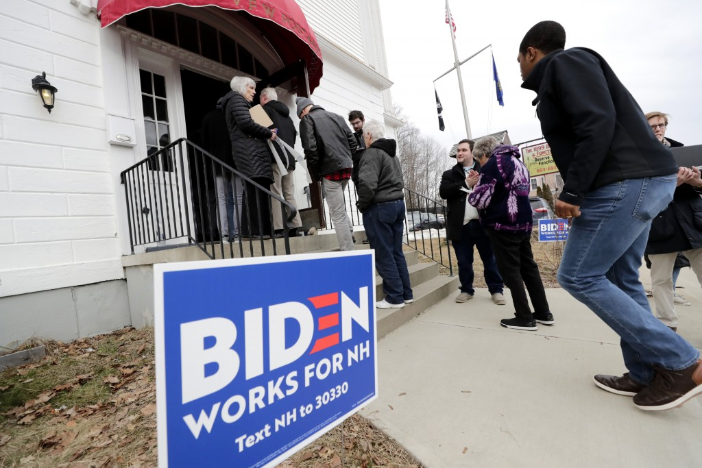 People make their way in to a campaign event for Democratic presidential candidate former Vice President Joe Biden, Wednesday, Feb. 5, 2020, in Somers...