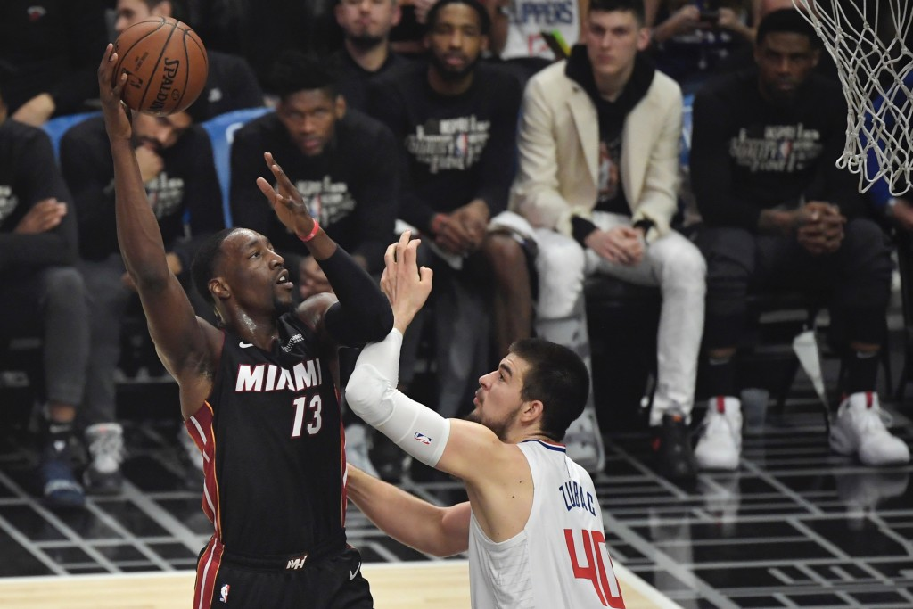 Miami Heat forward Bam Adebayo, left, shoots as Los Angeles Clippers center Ivica Zubac defends during the first half of an NBA basketball game Wednes...