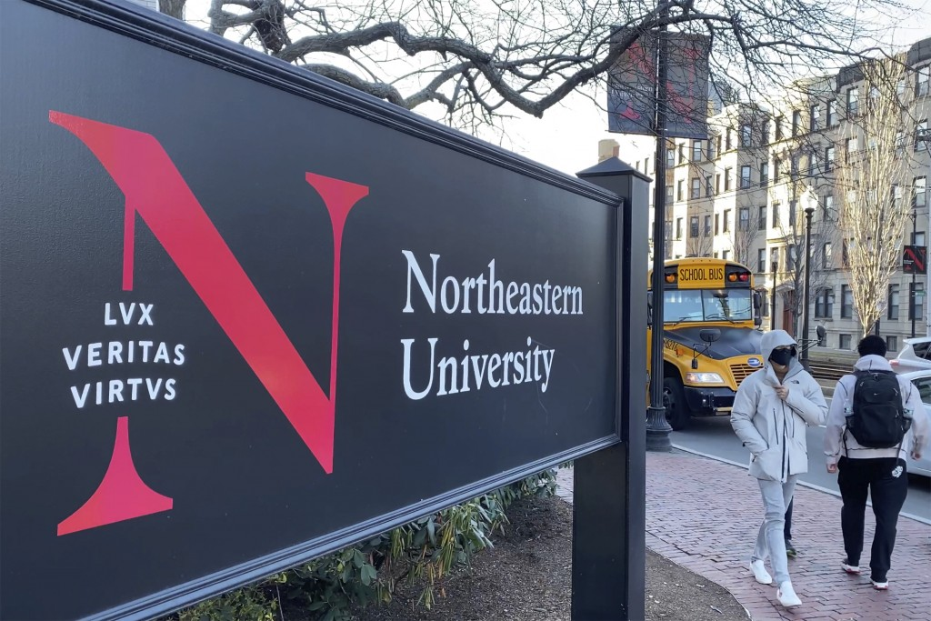 In this Jan. 31, 2019 photo, students walk on the Northeastern University campus in Boston. As concerns about China's virus outbreak spread, universit...