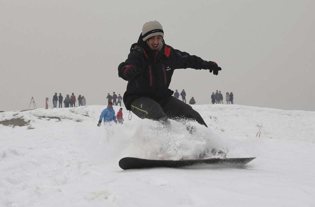 In this Friday, Jan. 24, 2020 photo, Ahmad Sorush, 22, a member of the Afghanistan Snowboarding Federation practices on the outskirts of Kabul, Afghan...
