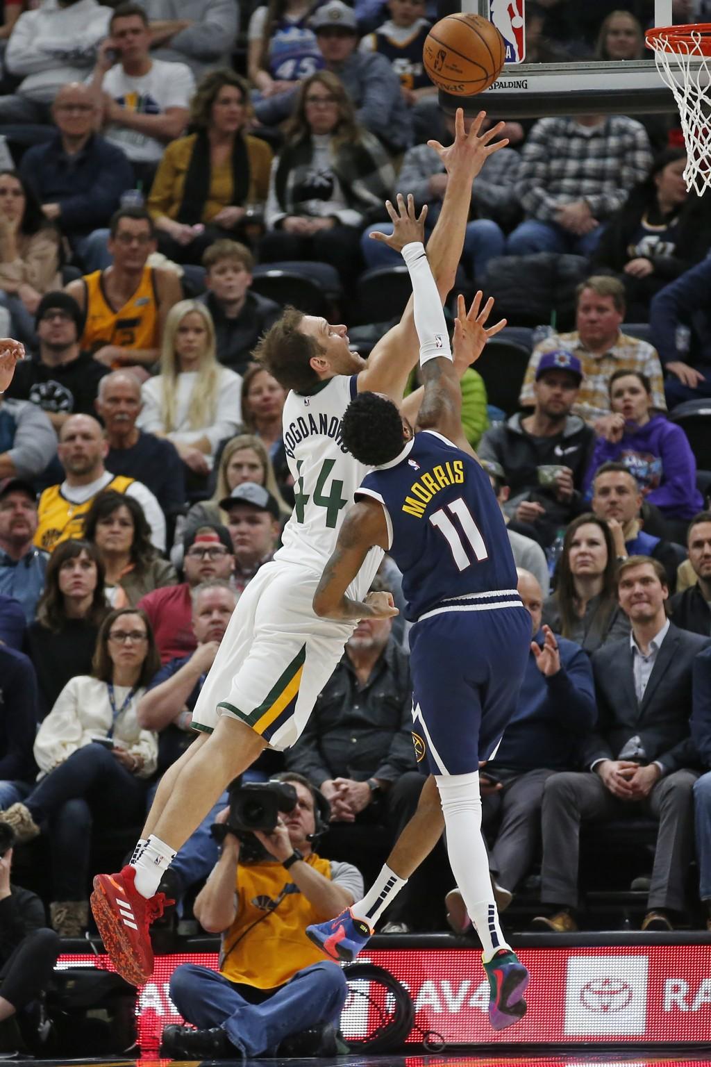 Utah Jazz forward Bojan Bogdanovic (44) goes to the basket as Denver Nuggets guard Monte Morris (11) defends in the first half during an NBA basketbal...