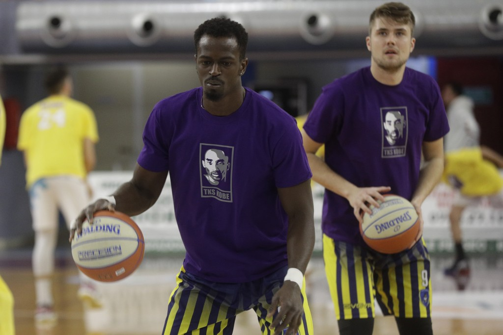 Players pay tribute to basketball legend Kobe Bryant as they warm up prior to the start of the Italian Basketball second division match between Rieti ...