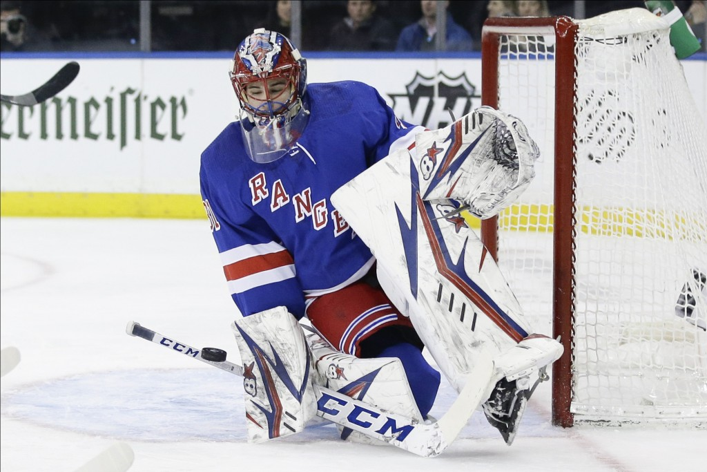 New York Rangers goaltender Igor Shesterkin (31) deflects a shot on goal during the first period of an NHL hockey game against the Toronto Maple Leafs...