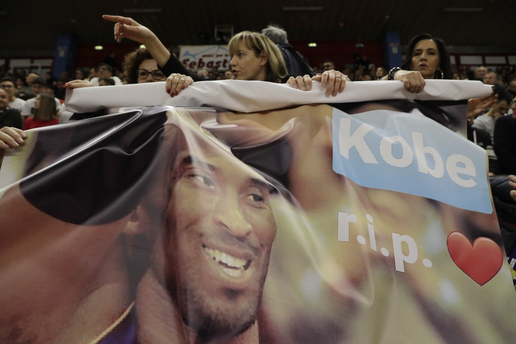 Spectators pay tribute to basketball legend Kobe Bryant prior to the start of the Italian Basketball second division match between Rieti and Scafati i...