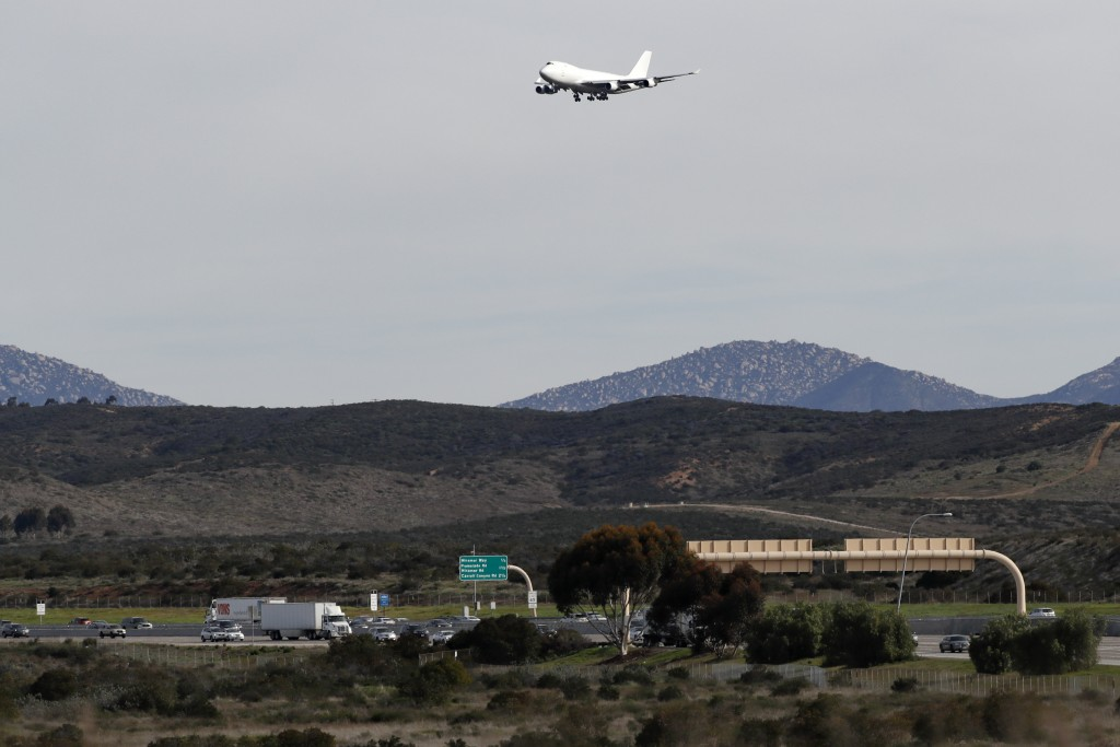 A plane carrying evacuees from the virus zone in China prepares to land at Marine Corps Air Station Miramar Wednesday, Feb. 5, 2020, in San Diego. One...