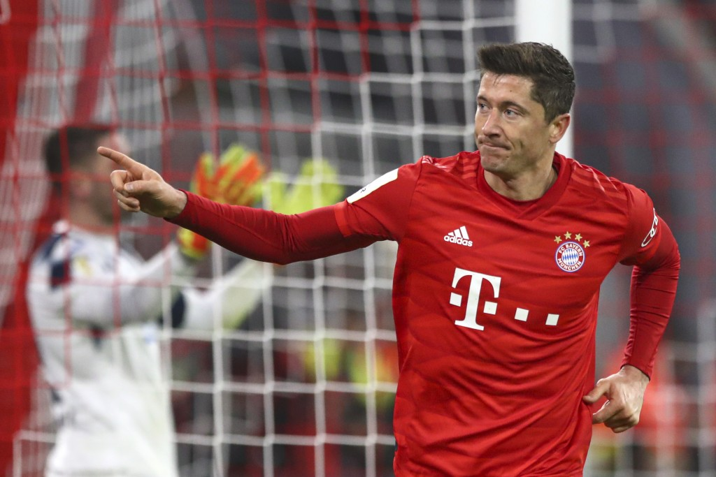 Bayern's Robert Lewandowski celebrates after scoring his side's fourth goal during the German soccer cup, DFB Pokal, match between FC Bayern Munich an...