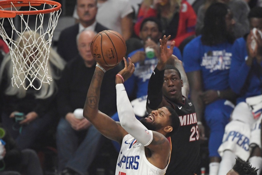 Los Angeles Clippers guard Paul George shoots as Miami Heat guard Kendrick Nunn defends during the first half of an NBA basketball game Wednesday, Feb...