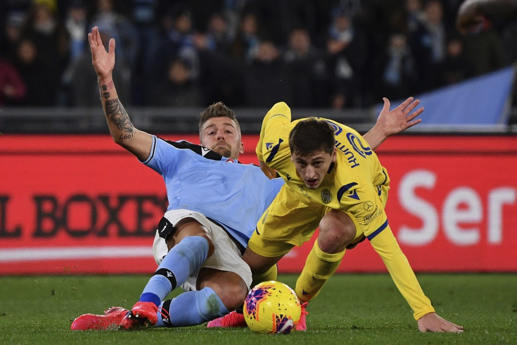 Lazio's Sergej Milinkovic-Savic, left, and Verona's Marash Kumbulla battle for the ball during the Italian Serie A soccer match between Lazio and Hell...