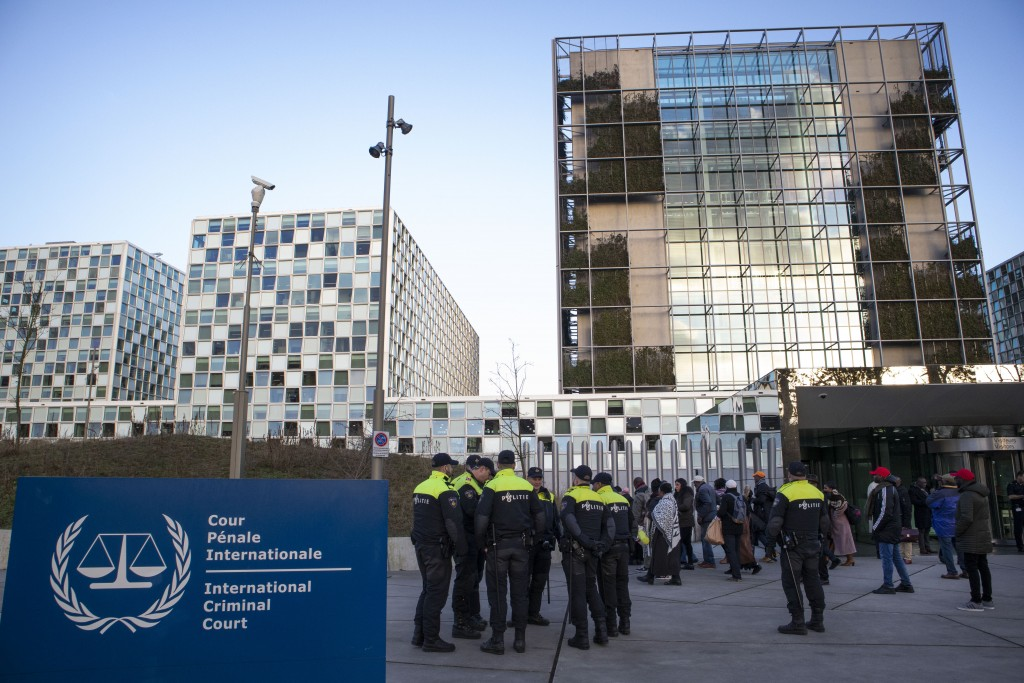 Police escorts a group of supporters of former Ivory Coast president Laurent Gbagbo outside the International Criminal Court in The Hague, Netherlands...