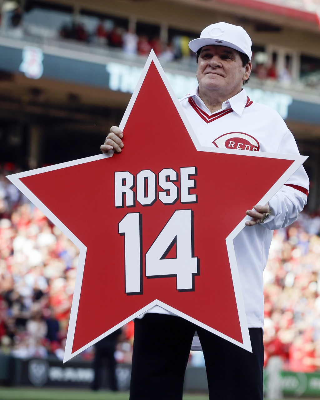 FILE -In this June 24, 2016, file photo, former Cincinnati Reds player Pete Rose (14) holds his place marker during a ceremony to honor the 1976 World...