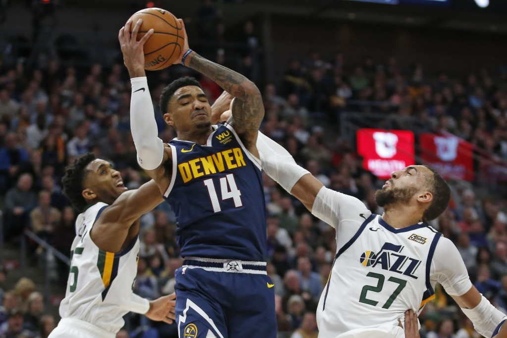 Denver Nuggets guard Gary Harris (14) pulls down a rebound as Utah Jazz's Donovan Mitchell, left, and Rudy Gobert (27) defend during the second half d...