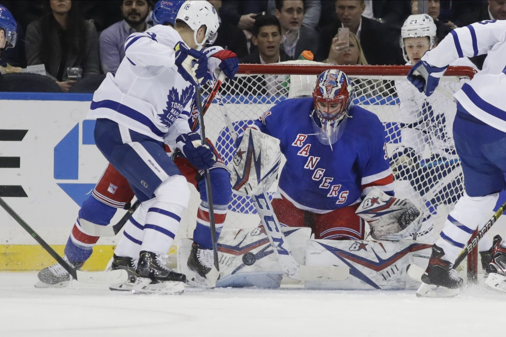 New York Rangers goaltender Igor Shesterkin (31) stops a shot on goal by Toronto Maple Leafs' Andreas Johnsso, left, during the second period of an NH...