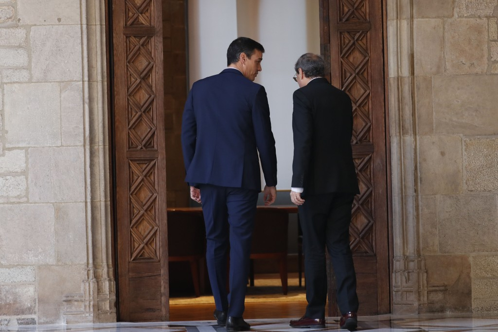 Spanish Prime Minister Pedro Sanchez, left, and Catalan regional President Quim Torra meet at the Palace of the Generalitat, the headquarter of the Go...