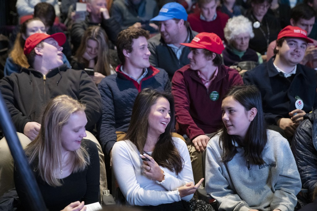 Students from local high schools and universities sit in the audience as they wait for the next speaker during the New Hampshire Youth Climate and Cle...