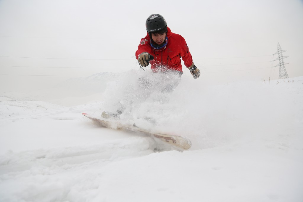 In this Friday, Jan. 24, 2020 photo, Mohammad Farzad, 20, a member of the Afghanistan Snowboarding Federation practices session on the snow-covered hi...