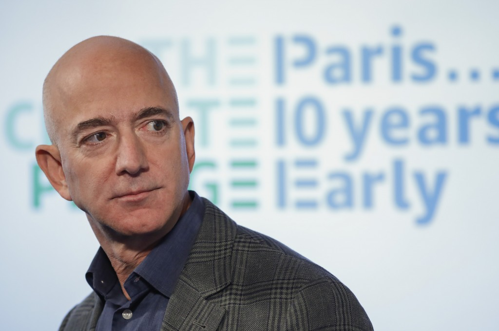 FILE - In this Sept. 19, 2019 file photo, Amazon CEO Jeff Bezos speaks during his news conference at the National Press Club in Washington. On Monday,...