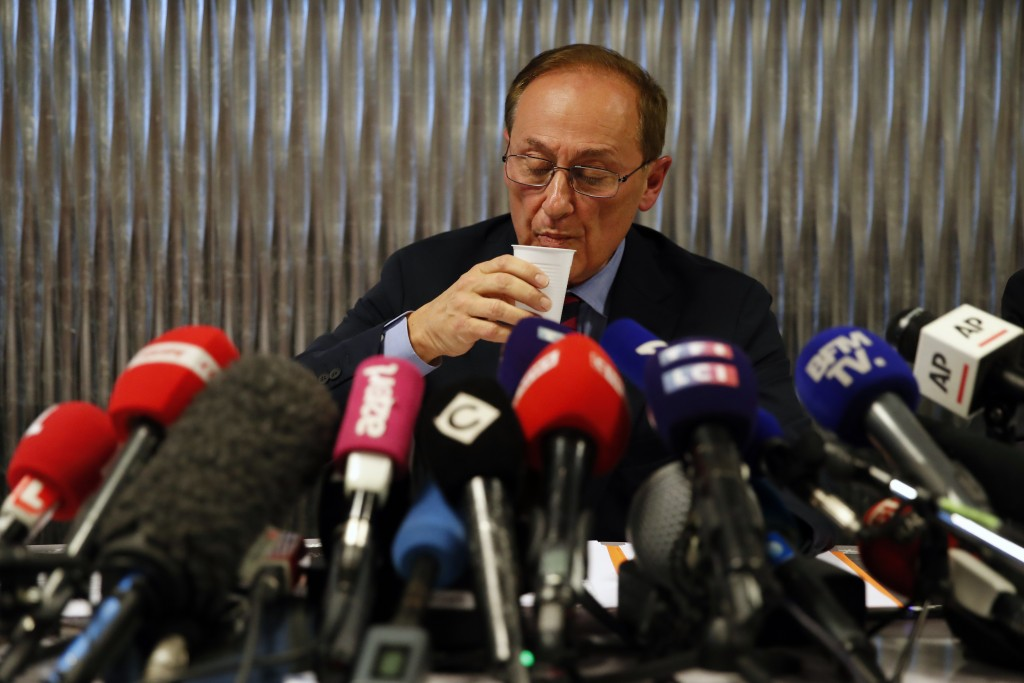 French Ice Skating Federation (FFSG) president Didier Gailhaguet takes a drink as he speaks to the media during a press conference in Paris, Wednesday...