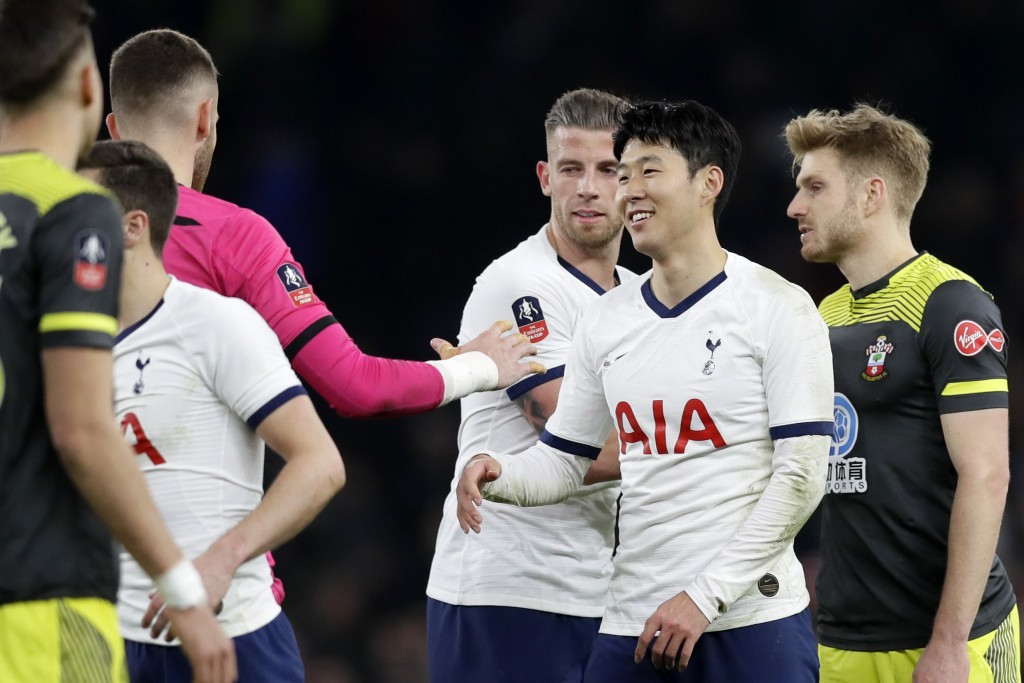 Tottenham's Son Heung-min, 2nd right, shakes hands with Southampton's goalkeeper Angus Gunn at the end of the English FA Cup fourth round replay socce...