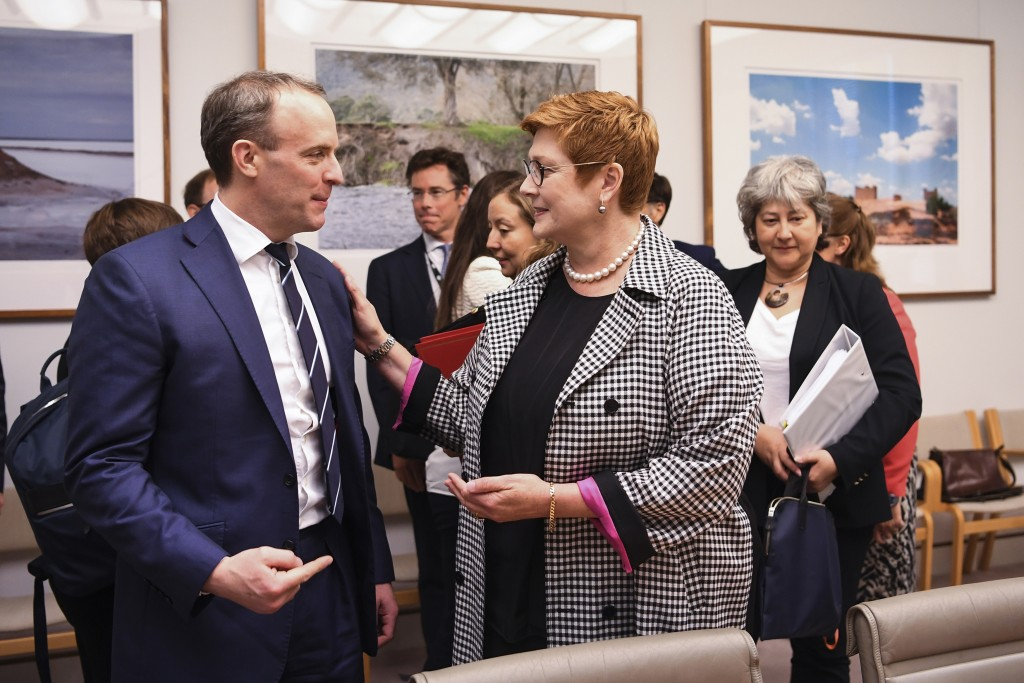 Britain's Foreign Secretary Dominic Raab, left, and Australian Foreign Minister Marise Payne speak ahead of a bilateral meeting at Parliament House in...