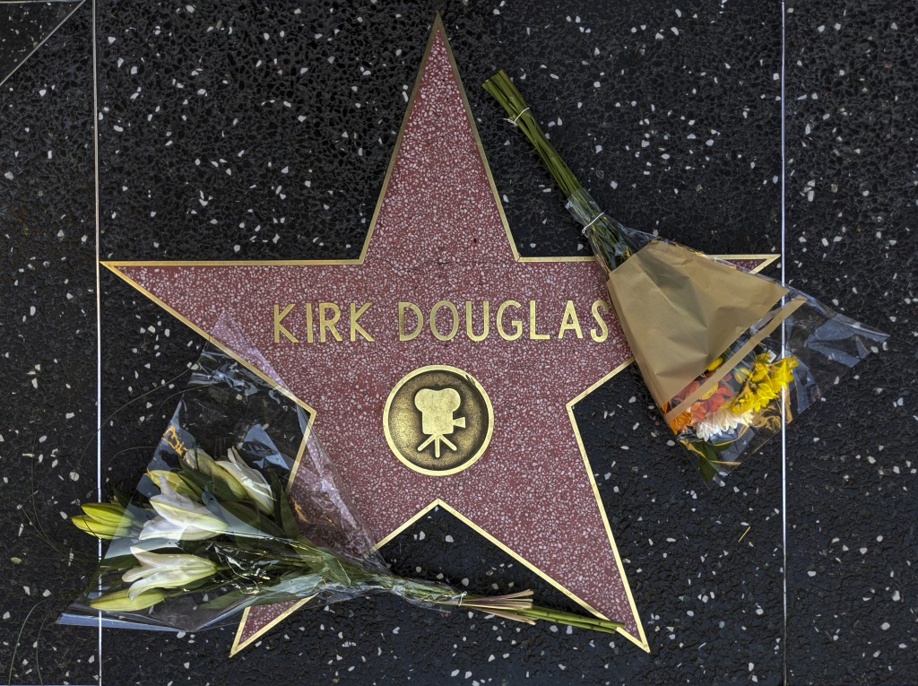 Flowers are placed on actor Kirk Douglas' star on the Hollywood Walk of Fame in Los Angeles, Wednesday, Feb. 5, 2020. Douglas, the muscular actor with...
