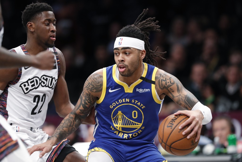 Golden State Warriors guard D'Angelo Russell (0) drives next to Brooklyn Nets guard Caris LeVert (22) during the first half of an NBA basketball game ...