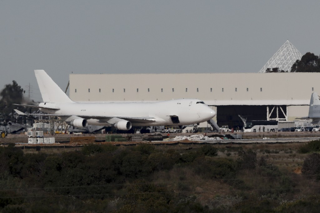 A plane carrying evacuees from the virus zone in China arrives at Marine Corps Air Station Miramar Wednesday, Feb. 5, 2020, in San Diego. One of two j...