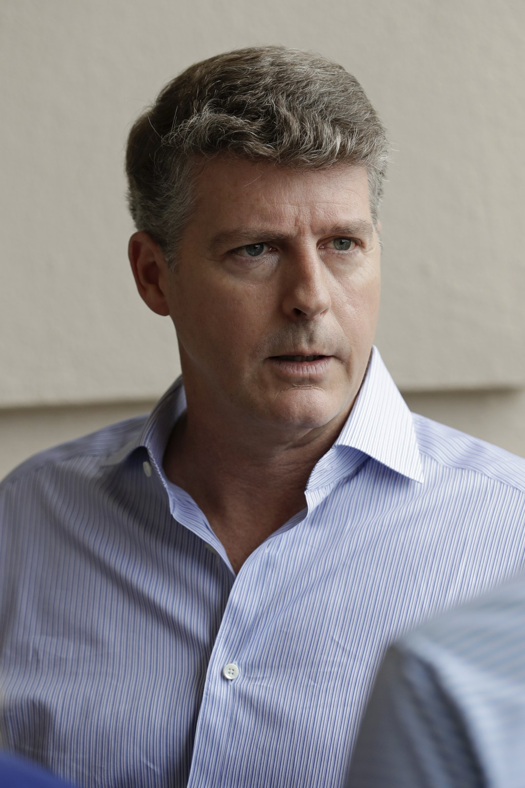 Hal Steinbrenner, principal owner of the New York Yankees, talks with reporters during MLB baseball owners meetings, Wednesday, Feb. 5, 2020, in Orlan...