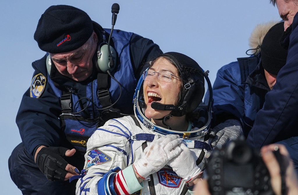 U.S. astronaut Christina Koch reacts shortly after the landing of the Russian Soyuz MS-13 space capsule about 150 km ( 80 miles) south-east of the Kaz...