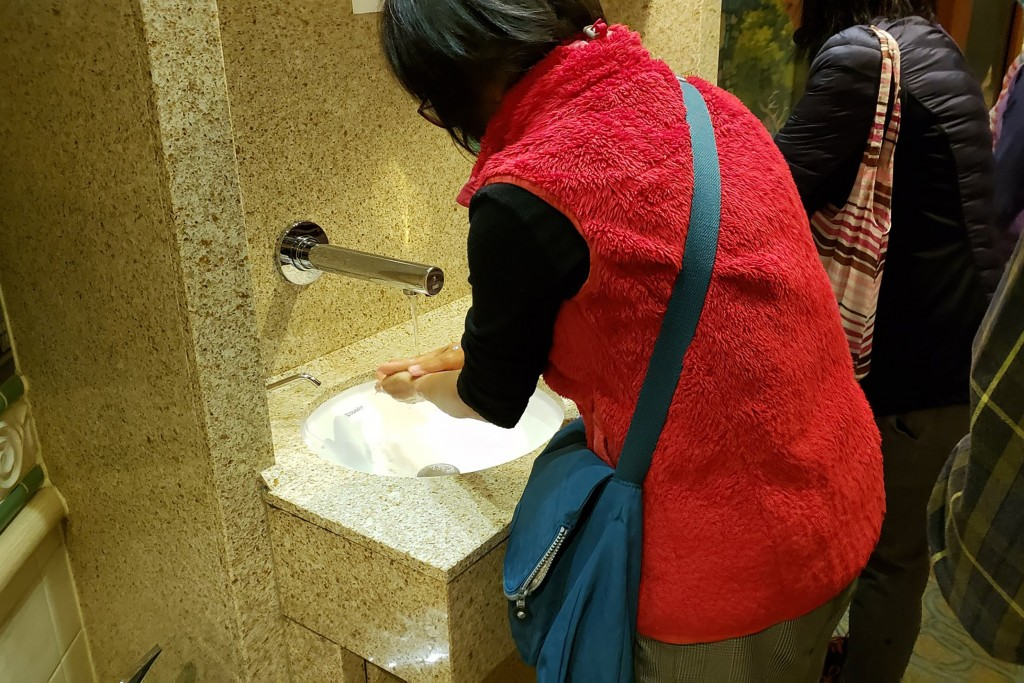 In this Monday, Feb. 3, 2020, photo taken by the passenger, another passengers wash their hands on the cruise ship Diamond Princess anchored off Yokoh...